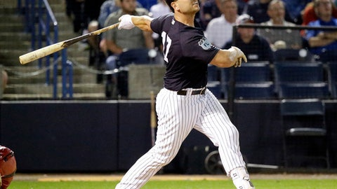FILE - In this March 21, 2017, file photo, New York Yankees' Matt Holliday hits a 2-run home run in the sixth inning against the Boston Red Sox in a spring training baseball game, in Tampa, Fla. Holliday signed with the Yankees after 7 1/2 seasons in St. Louis. (AP Photo/John Raoux, File)