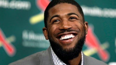 FILE - In this Dec. 9, 2016, file photo, Dexter Fowler smiles during an introductory news conference announcing the free agent center fielder has signed with the St. Louis Cardinals, in St. Louis. On Sunday, April 2, 2017, one of baseball's best rivalries takes on a new look when the World Series champion Cubs kick off their title defense against Dexter Fowler and the Cardinals. (AP Photo/Jeff Roberson, File)