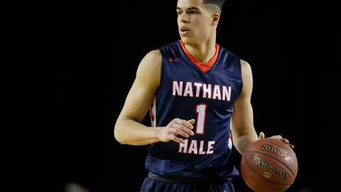 FILE - In this March 4, 2017, file photo, Nathan Hale forward Michael Porter Jr. dribbles downcourt against Garfield in the first half of the Washington state boys 3A high school basketball championship in Tacoma, Wash. The University of Washington released Porter from his national letter of intent. The university confirmed the decision  on Thursday, March 23, 2017, one day after new Washington coach Mike Hopkins was formally introduced. Porter is widely regarded as the top high school senior in the country.  (AP Photo/Ted S. Warren, File)