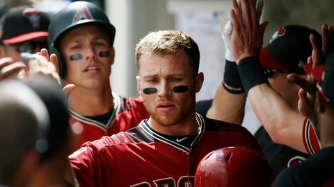 Arizona Diamondbacks' Brandon Drury, middle, gets high-fives from teammates after he scored on a two-run home run by Jake Lamb, left, during the first inning of a spring training baseball game against the Chicago Cubs on Thursday, March 23, 2017, in Scottsdale, Ariz. (AP Photo/Ross D. Franklin)