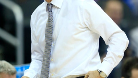 Michigan coach John Beilein watches from the bench during the first half of the team's regional semifinal against Oregon in the NCAA men's college basketball tournament, Thursday, March 23, 2017, in Kansas City, Mo. (AP Photo/Orlin Wagner)