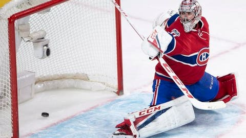 Montreal Canadiens goalie Carey Price gives up a goal to the Carolina Hurricanes during the second period of an NHL hockey game Thursday, March 23, 2017, in Montreal. (Ryan Remiorz/The Canadian Press via AP)