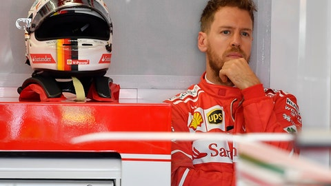 Ferrari driver Sebastian Vettel of Germany waits at the rear of his team garage during the first practice session for the Australian Grand Prix in Melbourne, Australia, Friday, March 24, 2017. (AP Photo/Andrew Brownbill)