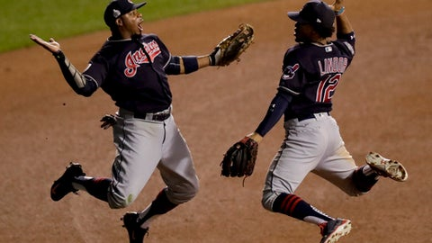 FILE - In this Oct. 29, 2016, file photo, Cleveland Indians left fielder Rajai Davis, left, and shortstop Francisco Lindor celebrate their win after Game 4 of the Major League Baseball World Series against the Chicago Cubs, in Chicago. Now that the Cubs have broken baseball's oldest curse, who's next? Maybe it's the Indians' turn.  (AP Photo/Charles Rex Arbogast, File)