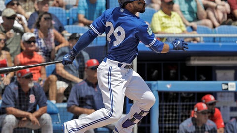 Toronto Blue Jays' Devon Travis hits an RBI double off Boston Red Sox starting pitcher Drew Pomeranz during the second inning of a spring training baseball game Friday, March 24, 2017, in Dunedin, Fla. Blue Jays' Kevin Pillar scored. (AP Photo/Chris O'Meara)
