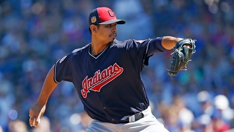 Cleveland Indians' Carlos Carrasco throws a pitch to the Chicago Cubs during the first inning of a spring training baseball game Friday, March 24, 2017, in Mesa, Ariz. (AP Photo/Ross D. Franklin)