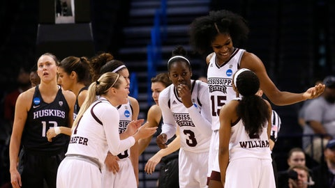 Mississippi State's Teaira McCowan (15) and Breanna Richardson (3) celebrates with teammates during the second half of a regional semifinal against Washington in the NCAA women's college basketball tournament, Friday, March 24, 2017, in Oklahoma City. (AP Photo/Sue Ogrocki)