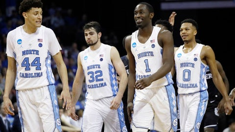 North Carolina players walk down the court in the closing moments of the second half of an NCAA college basketball tournament South Regional semifinal game against Butler, Friday, March 24, 2017, in Memphis, Tenn. North Carolina won 92-80. (AP Photo/Mark Humphrey)