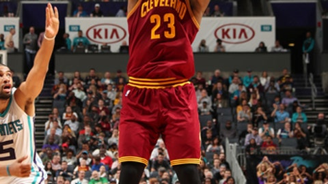 CHARLOTTE, NC - MARCH 24:  LeBron James #23 of the Cleveland Cavaliers shoots the ball during a game against the Charlotte Hornets on March 24, 2017 at the Spectrum Center in Charlotte, North Carolina. NOTE TO USER: User expressly acknowledges and agrees that, by downloading and/or using this photograph, user is consenting to the terms and conditions of the Getty Images License Agreement. Mandatory Copyright Notice: Copyright 2017 NBAE (Photo by Kent Smith/NBAE via Getty Images)