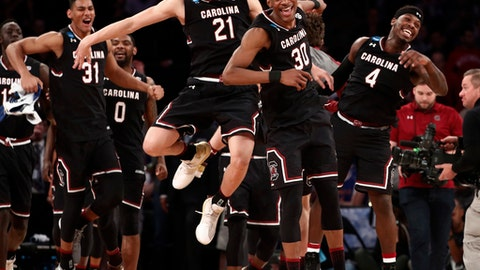 South Carolina players celebrate after beating Baylor 70-50 in an East Regional semifinal game of the NCAA men's college basketball tournament, Friday, March 24, 2017, in New York. (AP Photo/Julio Cortez)