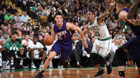 BOSTON, MA - MARCH 24:  Devin Booker #1 of the Phoenix Suns drives to the basket against the Boston Celtics on March 24, 2017 at the TD Garden in Boston, Massachusetts.  NOTE TO USER: User expressly acknowledges and agrees that, by downloading and or using this photograph, User is consenting to the terms and conditions of the Getty Images License Agreement. Mandatory Copyright Notice: Copyright 2017 NBAE  (Photo by Brian Babineau/NBAE via Getty Images)