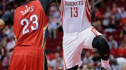HOUSTON, TX - MARCH 24:  James Harden #13 of the Houston Rockets drives past Anthony Davis #23 of the New Orleans Pelicans during the first quarter at Toyota Center on March 24, 2017 in Houston, Texas. NOTE TO USER: User expressly acknowledges and agrees that, by downloading and/or using this photograph, user is consenting to the terms and conditions of the Getty Images License Agreement.  (Photo by Bob Levey/Getty Images)