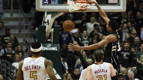 MILWAUKEE, WI - MARCH 24:  Giannis Antetokounmpo #34 of the Milwaukee Bucks dunks against the Atlanta Hawks during the first half of a game at the BMO Harris Bradley Center on March 24, 2017 in Milwaukee, Wisconsin. NOTE TO USER: User expressly acknowledges and agrees that, by downloading and or using this photograph, User is consenting to the terms and conditions of the Getty Images License Agreement.  (Photo by Stacy Revere/Getty Images)