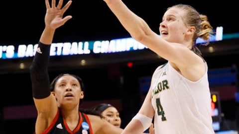 Louisville forward Cortnee Walton (13) defends as Baylor guard Kristy Wallace (4) of Australia goes up for a shot during the second half of a regional semifinal of the NCAA women's college basketball tournament, Friday, March 24, 2017, in Oklahoma City. (AP Photo/Sue Ogrocki)