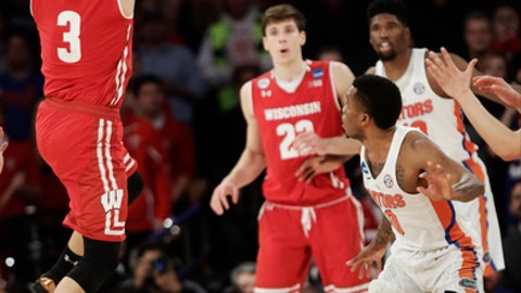 Wisconsin guard Zak Showalter (3) puts up a 3-point shot against Florida to tie the game with 2.5 seconds left in regulation of an East Regional semifinal game of the NCAA men's college basketball tournament, Saturday, March 25, 2017, in New York. (AP Photo/Frank Franklin II)