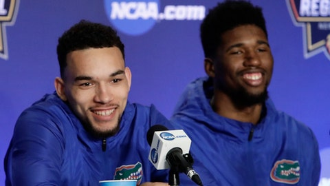 Florida's Chris Chiozza, left, and Kevarrius Hayes, right, smile during a news conference Saturday, March 25, 2017, in New York. Florida plays South Carolina in the East Regional final at the NCAA college basketball tournament . (AP Photo/Frank Franklin II)