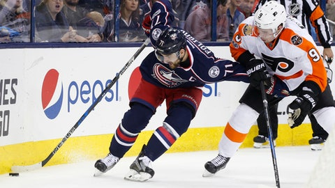 Columbus Blue Jackets' Nick Foligno, left, keeps the puck away from Philadelphia Flyers' Ivan Provorov, of Russia, during the second period of an NHL hockey game, Saturday, March 25, 2017, in Columbus, Ohio. (AP Photo/Jay LaPrete)