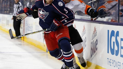 Columbus Blue Jackets' Seth Jones, left, and Philadelphia Flyers' Brayden Schenn skate after a loose puck during the third period of an NHL hockey game Saturday, March 25, 2017, in Columbus, Ohio. The Blue Jackets beat the Flyers 1-0. (AP Photo/Jay LaPrete)