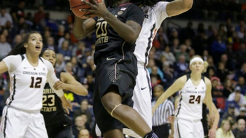 Florida State forward Shakayla Thomas, left, goes to the basket against Oregon State center Breanna Brown during the first half of a regional semi-final round game of an NCAA college basketball tournament, Saturday, March 25, 2017, in Stockton, Calif. (AP Photo/Rich Pedroncelli)