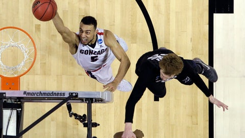 Gonzaga guard Nigel Williams-Goss (5) shoots past Xavier guard J.P. Macura during the second half of an NCAA Tournament college basketball regional final game Saturday, March 25, 2017, in San Jose, Calif. (AP Photo/Tony Avelar)