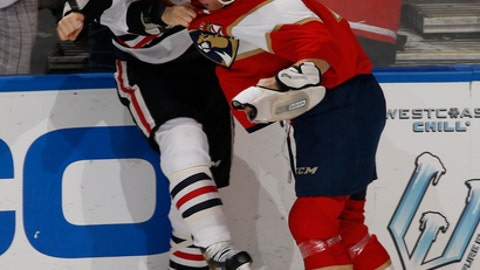 Chicago Blackhawks center Andrew Desjardins (11) and Florida Panthers right wing Shawn Thornton (22) fight during the third period of an NHL hockey game, Saturday, March 25, 2017, in Sunrise, Fla. The Panthers defeated the Blackhawks 7-0. (AP Photo/Joel Auerbach)