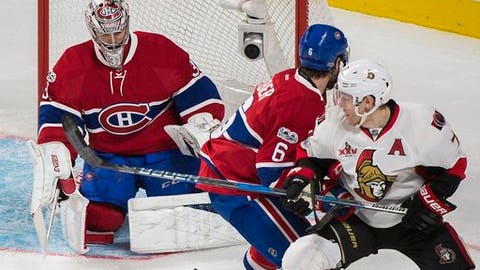 Ottawa Senators' Kyle Turris (7) moves in on Montreal Canadiens goalie Carey Price as Canadiens' Shea Weber (6) defends during the third period of an NHL hockey game Saturday, March 25, 2017, in Montreal. (Graham Hughes/The Canadian Press via AP)