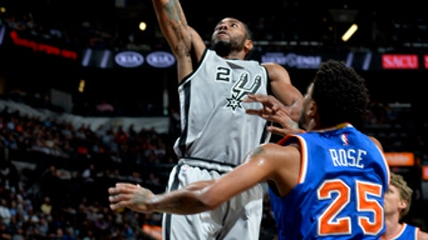 SAN ANTONIO, TX - MARCH 25: Kawhi Leonard #2 of the San Antonio Spurs shoots the ball during the game against the New York Knicks on March 25, 2017 at the AT&T Center in San Antonio, Texas. NOTE TO USER: User expressly acknowledges and agrees that, by downloading and or using this photograph, user is consenting to the terms and conditions of the Getty Images License Agreement. Mandatory Copyright Notice: Copyright 2017 NBAE (Photos by Mark Sobhani/NBAE via Getty Images)
