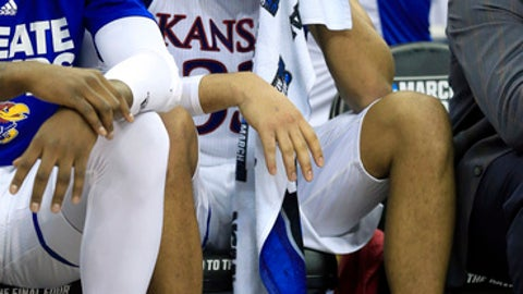 Kansas forward Landen Lucas sits on the bench during the second half of the team's Midwest Regional final against Oregon in the NCAA men's college basketball tournament, Saturday, March 25, 2017, in Kansas City, Mo. Oregon won 74-60. (AP Photo/Orlin Wagner)