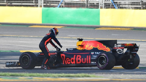 Red Bull driver Daniel Ricciardo of Australia gets out of his car after stopping during the Australian Formula One Grand Prix in Melbourne, Australia, Sunday, March 26, 2017. (AP Photo/Andy Brownbill)