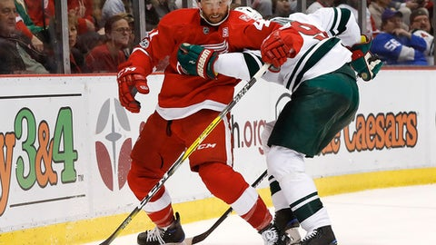 Minnesota Wild center Mikko Koivu (9) holds Detroit Red Wings center Luke Glendening (41) in the second period of an NHL hockey game Sunday, March 26, 2017, in Detroit. (AP Photo/Paul Sancya)