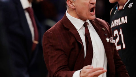 South Carolina head coach Frank Martin reacts during the first half of the East Regional championship game against Florida in the NCAA men's college basketball tournament, Sunday, March 26, 2017, in New York. (AP Photo/Julio Cortez)