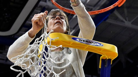 Stanford's head coach Tara VanDerveer pulls down the final bit of the net after her team defeated Notre Dame 76-75 to win the Lexington regional final of the NCAA women's college basketball tournament, Sunday, March. 26, 2017, in Lexington, Ky. (AP Photo/Timothy D. Easley)
