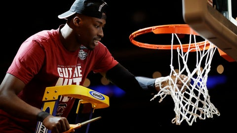 South Carolina forward Sedee Keita cuts down the net after South Carolina beat Florida 77-70 in the East Regional championship game of the NCAA men's college basketball tournament, Sunday, March 26, 2017, in New York. (AP Photo/Julio Cortez)