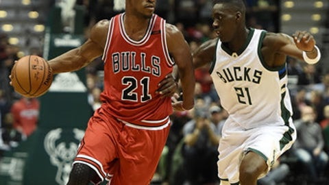 MILWAUKEE, WI - MARCH 26:  Jimmy Butler #21 of the Chicago Bulls is defended by Tony Snell #21 of the Milwaukee Bucks during the first half of a game at the BMO Harris Bradley Center on March 26, 2017 in Milwaukee, Wisconsin. NOTE TO USER: User expressly acknowledges and agrees that, by downloading and or using this photograph, User is consenting to the terms and conditions of the Getty Images License Agreement.  (Photo by Stacy Revere/Getty Images)