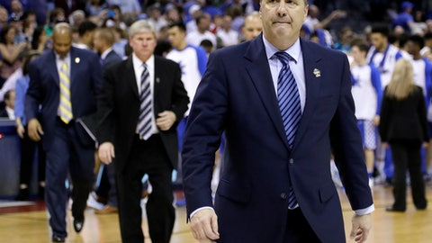 Kentucky head coach John Calipari leaves the court after losing 75-73 to North Carolina in the South Regional final game in the NCAA college basketball tournament Sunday, March 26, 2017, in Memphis, Tenn. (AP Photo/Mark Humphrey)
