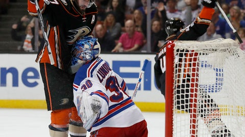 Anaheim Ducks center Ryan Kesler, left, runs into New York Rangers goalie Henrik Lundqvist, of Sweden, as defenseman Josh Manson, right, skates away after scoring a goal during the second period of an NHL hockey game, Sunday, March 26, 2017, in Anaheim, Calif. (AP Photo/Ryan Kang)