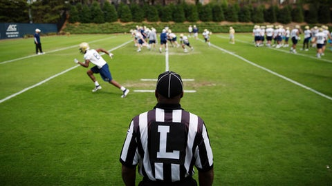 A referee officiates a play during a Georgia Tech NCAA college football practice in Atlanta, Monday, March 27, 2017. Coming off a nine-win season, Georgia Tech begins spring football practice Monday with all eyes on the quarterback position after the departure of three-year starter Justin Thomas. (AP Photo/David Goldman)