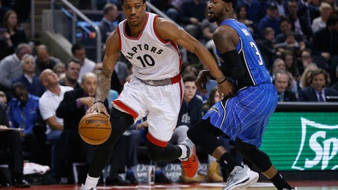 TORONTO, ON - MARCH 27: Toronto Raptors guard DeMar DeRozan (10) blows past former teammate, Orlando Magic forward Terrence Ross (31). Toronto Raptors vs Orlando Magic in 1st half action of NBA regular season play at Air Canada Centre. Toronto Star/Rick Madonik        (Rick Madonik/Toronto Star via Getty Images)