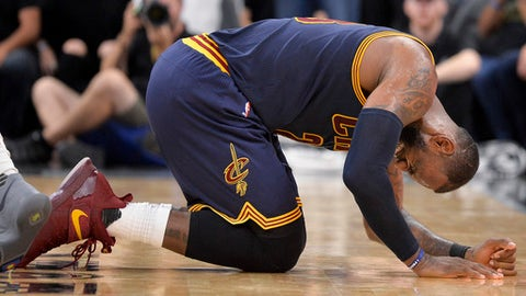 Cleveland Cavaliers forward LeBron James falls to the floor during the second half of an NBA basketball game against the San Antonio Spurs, Monday, March 27, 2017, in San Antonio. (AP Photo/Darren Abate)