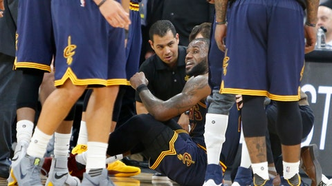 SAN ANTONIO,TX - MARCH 27: LeBron James #23 of the Cleveland Cavaliers is attended to by trainers after he went down during game against the San Antonio Spurs at AT&T Center on March 27, 2017 in San Antonio, Texas.  NOTE TO USER: User expressly acknowledges and agrees that , by downloading and or using this photograph, User is consenting to the terms and conditions of the Getty Images License Agreement. (Photo by Ronald Cortes/Getty Images)