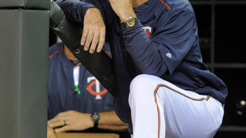 "In this Sept. 1, 2016, photo, Minnesota Twins manager Paul Molitor watches from the dugout during a baseball game in Minneapolis. ""We will try to use it as a springboard,"" said manager Paul Molitor, who described 2016 as the most difficult season he endured in any capacity, playing or coaching, over his life in the sport. ""It was very challenging."" (AP Photo/Tom Olmscheid)"
