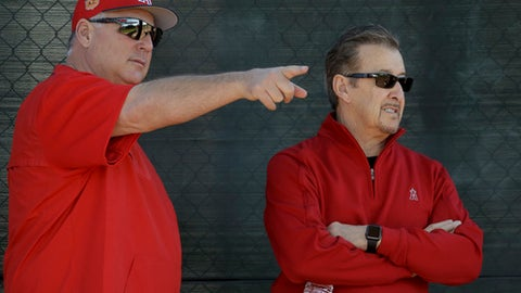FILE - In this Feb. 15, 2017, file photo, Los Angeles Angels owner Arte Moreno, right, and manager Mike Scioscia talk during spring baseball practice in Tempe, Ariz. The Angels got plenty of good breaks in 2014, when they won a big league-best 98 games and led the majors in runs scored.  The Angels got almost no breaks _ injury or otherwise _ last season while they finished 74-88, the worst record of manager Mike Scioscia's first 17 years in charge. (AP Photo/Chris Carlson, File)