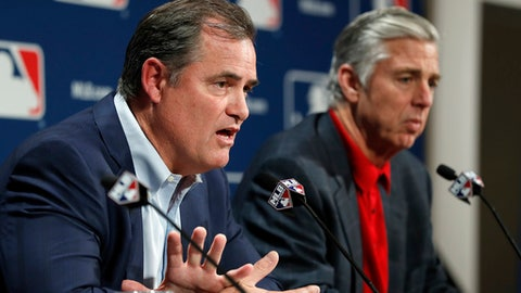 FILE - In this Dec. 6, 2016, file photo, Boston Red Sox manager John Farrell, left, and Boston Red Sox president of baseball operations Dave Dombrowski answer questions from the media during Major League Baseball's winter meetings, in Oxon Hill, Md. Though their playoff return ended in a swift exit via an AL Division sweep at the hands of the Cleveland Indians, the run to a division title revealed just how much potential the core of their roster has.  (AP Photo/Alex Brandon, File)