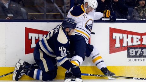 Buffalo Sabres defenseman Dmitry Kulikov, right, of Russia, stops a pass against Columbus Blue Jackets forward Lukas Sedlak, of the Czech Republic, during the second period of an NHL hockey game in Columbus, Ohio, Tuesday, March 28, 2017. (AP Photo/Paul Vernon)