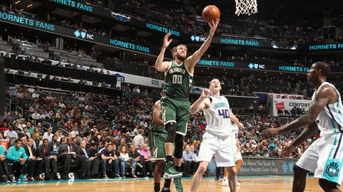 CHARLOTTE, NC - MARCH 28:  Spencer Hawes #00 of the Milwaukee Bucks grabs the rebound against the Charlotte Hornets on March 28, 2017 at Spectrum Center in Charlotte, North Carolina. NOTE TO USER: User expressly acknowledges and agrees that, by downloading and or using this photograph, User is consenting to the terms and conditions of the Getty Images License Agreement.  Mandatory Copyright Notice:  Copyright 2017 NBAE (Photo by Kent Smith/NBAE via Getty Images)