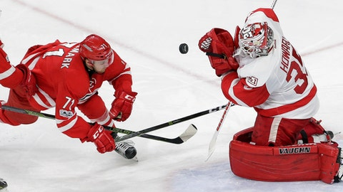 Detroit Red Wings goalie Jimmy Howard (35) defends the goal against Carolina Hurricanes' Lucas Wallmark (71), of Sweden, during the third period of an NHL hockey game in Raleigh, N.C., Tuesday, March 28, 2017. Carolina won 4-1. (AP Photo/Gerry Broome)