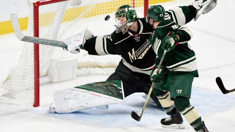 Minnesota Wild goalie Devan Dubnyk (40) and defenseman Jared Spurgeon (46) watch as a shot by Washington Capitals left wing Alex Ovechkin (not pictured), of Russia, scores a goal on the power play during the second period of an NHL hockey game, Tuesday, March 28, 2017, in St. Paul, Minn. (AP Photo/Hannah Foslien)