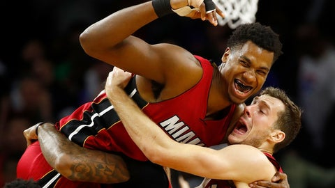 AUBURN HILLS, MI - MARCH 28: Hassan Whiteside #21 of the Miami Heat celebrates his buzzer beating game winning basket with Goran Dragic #7 while playing the Detroit Pistons at the Palace of Auburn Hills on March 28, 2017 in Auburn Hills, Michigan. NOTE TO USER: User expressly acknowledges and agrees that, by downloading and or using this photograph, User is consenting to the terms and conditions of the Getty Images License Agreement.  (Photo by Gregory Shamus/Getty Images)