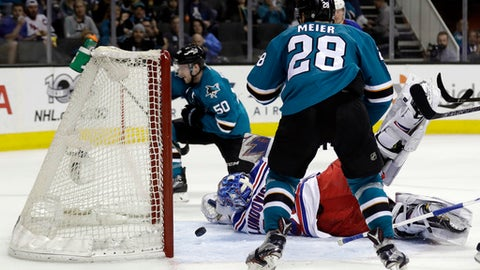 New York Rangers goalie Henrik Lundqvist, center, is beaten for a goal on a shot from San Jose Sharks center Chris Tierney (50) during the second period of an NHL hockey game Tuesday, March 28, 2017, in San Jose, Calif. (AP Photo/Marcio Jose Sanchez)