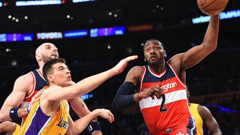 LOS ANGELES, CA - MARCH 28: John Wall #2 of the Washington Wizards drives to the basket against Ivica Zubac #40 of the Los Angeles Lakersduring the first half of the basketball game at Staples Center March 28, 2017, in Los Angeles, California. NOTE TO USER: User expressly acknowledges and agrees that, by downloading and or using this photograph, User is consenting to the terms and conditions of the Getty Images License Agreement. (Photo by Kevork Djansezian/Getty Images)